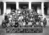 Group portrait of children and adults in front of the Tientsin Jewish School, October 7, 1934