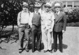 Four men wearing light-colored fedoras standing outdoors, possibly Steinberg family members, n.d.