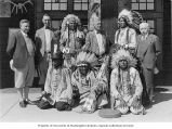 Nathan I. Neubauer and three other men with group of Native Americans, ca. 1920