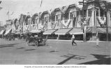 Wenatchee Department Store exterior decorated with American flags, Wenatchee, Washington, ca. 1910