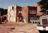 Cleared lot in front of buildings during demolition of Temple de Hirsch Sinai, August 1992
