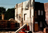 Side wall with lift parked in front during demolition of Temple de Hirsch Sinai, August 1992