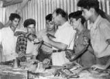 Young men and instructor working with tools, Israel, ca. 1957