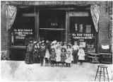 Group in front of Red Front Furniture Company, 308-310 2nd Ave. S. after a parade, Seattle, ca....