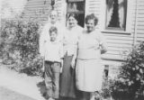 Harry Goldberg as a boy with grandmother Sophie Handlin (center) and two other people, circa 1920s
