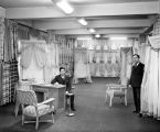 Morris Israel (left) and Ralph Capeluto (right) in showroom of Seattle Curtain in the Prefontaine...