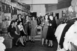 Seattle Curtain female employees celebrating in stock area, Seattle, ca. 1932-1941