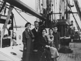 Amelia Capeluto (center) and family aboard ship during emigration voyage from Isle of Rhodes to...