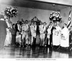 Men holding Torah scrolls during Kol Nidre service at Congregation Ezra Bessaroth synagogue,...