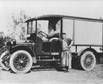 Moris Gordon with Gordon and Woron Packing Company delivery truck, Seattle, 1924
