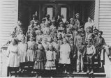 Schoolchildren on steps of school, Republic, Washington, ca. 1916