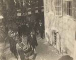 Mario Lago (center), Governor of Rhodes, receiving Fascist salute from students during visit to...