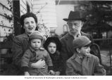 Ethel Chaiken Lippman (left) with her grandfather Menachem Mendel Chaiken and her three children,...