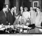 Governor Albert Rosellini signing first state law prohibiting discrimination in public...