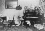 Henry Kleinberg home interior showing living room with piano, Ellensburg, ca. 1900-1912