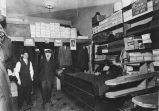 Lewis Lewis (right) and unidentified man in Lewis' clothing store interior, Victoria, British...