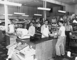 24th Avenue Market interior with owners Isaac (left) and Sam (3rd from left) Maimon and employees,...