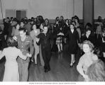 Military servicemen and hostesses dancing at U.S.O. canteen, Seattle, circa 1944