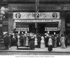 Exterior of Hoffman Cloak & Suit Company with crowd in front, Seattle, July 25, 1913