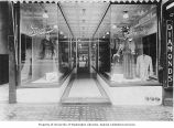 Paragon Cloak & Suit Company display windows with mannequins at 1420 Second Ave., Seattle,...