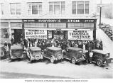 Everybody's Store with cars parked in front and crowd awaiting overstock sale, Seattle, n.d.
