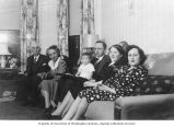 Louis Hoffman with his son and daughters seated on couch, circa 1947