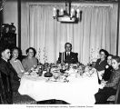 Hoffman family seated around Louis I. Hoffman's dining table, 1948