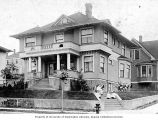 Hoffman home with Sarah Gottstein Hoffman and children sitting in front with dog, 1510 East...