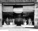 Storefront of the Novelty Skirt Manufacturing Company with mannequins in windows, 1316 Second...