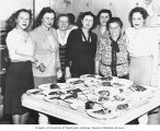 Group of women, mostly members of Herzl Congregation, helping to prepare or serve food at Hillel,...