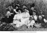 Newberger family members and others seated on grass, Seattle, Washington, ca. 1900