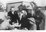 Rabbi Meier Ashkenazi (center) congratulating Henrietta Brown and Erwin Reifler at their wedding...
