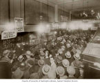 Weisfield & Goldberg Jewelers filled with customers during auction, 308 Pike St., Seattle, ca....