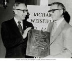 Sam Rubinstein (left) presenting Richard Weisfield with the American Jewish Committee (AJC)...