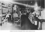 Carrie (Caroline) Wurzburg and Gene Harley inside Wurzburg Store, Marcus, Washington, 1919