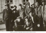 Rabbi Solomon Wohlgelernter (2nd row, 4th from left, with cap) with concentration camp survivors...