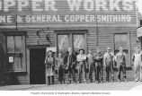 Alaskan Copper Works crew in front of Alaskan Copper Works building, Seattle, Washington, ca. 1918