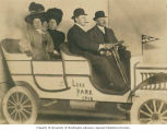 Jack Danciger (at wheel), Mrs. Danciger and Bessie Weixel's parents in prop car at Luna Park,...