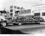 Schoenfeld's Standard Furniture Co. flatbed truck loaded with furniture, Seattle, Washington, ca....