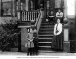 Mosler family members in front of Mosler Apartments, 1219-1223 Yesler Way, Seattle, ca. 1918