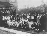 Family and friends gathered for the bris of Harry Schwartz, Seattle, Washington, 1907