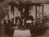 Shain family sitting on porch at farmhouse, Home Colony, Pierce County, Washington, ca. 1918