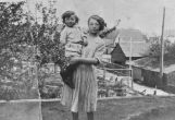 Hattie Abrashin (Brashen) Solomon holding younger brother Morris Abrashin (Brashen) in their...