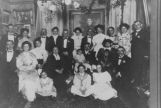 Rogers family gathered in living room of their Queen Anne home, 128 Aloha St., Seattle,...