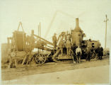 Photo of early steam powered ditch-digging machine, ca. 1923