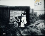 Photo of women posting suffrage posters, ?Seattle, 1910