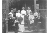 Kiehl family and others on steps of the Officers Quarters, Fort Lawton, Washington, 1901