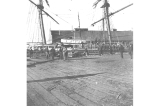 Schooner LUCILE loading supplies from a dock in Seattle, Washington,  February 15, 1898