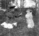 Miriam Kiehl playing with dog named Pedro, Magnolia Bluff, Seattle, Washington, February 4, 1900