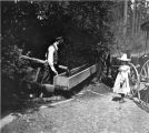 One of the Kiehl children watering the horses at a watering trough, Bothell, Washington, May 26,...